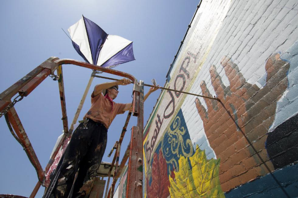 Man working on Mural